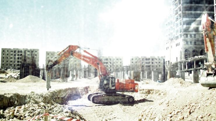 Palestijnen zijn hard aan het werk in Rawabi. Foto: © Alfred Muller